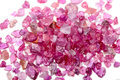 A pile of rough uncut pink red ruby natural and rubies Royalty Free Stock Photos