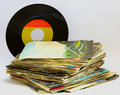 Pile of rpm vinyl records used and dirty even Royalty Free Stock Photography