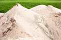 Pile of sand fine heaped up at a golf course Stock Photos