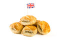 Pile of sausage rolls with union jack flag Stock Photography