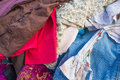 Pile of second hand clothes in a market stall Royalty Free Stock Photography