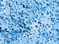 Pile of separated blue puzzle pieces close up Stock Photos
