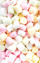 A pile of small colored puffy marshmallows may use as background close up top view Stock Photo
