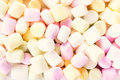 A pile of small colored puffy marshmallows may use as background close up top view Royalty Free Stock Image