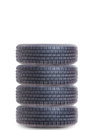 Pile stack or set of four car auto tires Royalty Free Stock Photo