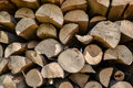 Pile of stacked firewood in rural garden ready for winter. Preparation for the winter. Wooden log abstract background Royalty Free Stock Photo