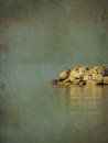 Pile of stones in the baltic sea a with horizon line background grunge style Royalty Free Stock Photo