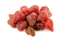 Pile of tasty red dried dehydrated strawberries detailed studio shot Stock Photo
