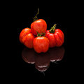 Pile tomato red-orange isolated on black Royalty Free Stock Photo