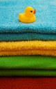 Pile of towels with a duckling Stock Image