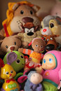 Pile of toys on a shelf in babys room Stock Images