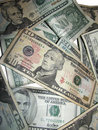Pile of US Dollars on White Stock Images
