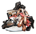 Pile of various female and male shoes over white Royalty Free Stock Photography