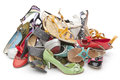 Pile various female shoes over white Royalty Free Stock Image