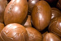 Pile of vintage old brown leather balls Royalty Free Stock Image