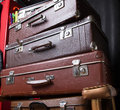 Pile of vintage suitcases on armchair Stock Image