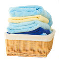 Pile of washed towel in basket isolated on white background Royalty Free Stock Images