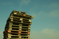 Pile of wood pallets like a tower Royalty Free Stock Photography