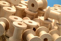 Pile of wooden bobbins closeup in Stock Photo