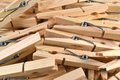 Pile wooden clothespins as background Royalty Free Stock Photography