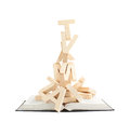 Pile of wooden letters over the book Royalty Free Stock Photo