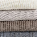 Pile of wool sweaters. Royalty Free Stock Photo