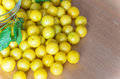 Pile of yellow mirabelle plums on wooden table stock photo Stock Photos