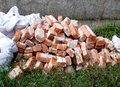 the piled old bricks of red color. were used for construction Royalty Free Stock Photo
