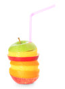 Piled slices of various fruits with drinking straw Royalty Free Stock Photography