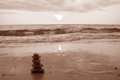 Piled up pebble stones on the sunset beach in sepia tone Royalty Free Stock Photo