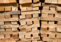 Piled wooden beams detail shot of three piles of Royalty Free Stock Image