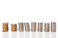 Piles of coins on white background with reflaxion Royalty Free Stock Photo