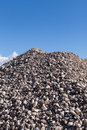 Piles of gravel at construction site under bright blue sky sand and Royalty Free Stock Photography