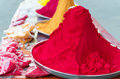 Piles and mounds of indian colorful dye powders for holy festival and religious purposes at open market Royalty Free Stock Photos