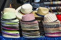 Piles with sunhats or summerhats in different colours Stock Photography