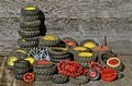 Piles of toy tractor tires and rims a collection old are displayed with a background weathered wood Stock Photos