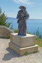 Pilgrim statue at cape finisterre galicia spain on the lighthouse of where pilgrims burn some object that has led during the Royalty Free Stock Photo