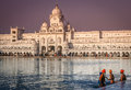 Pilgrims at the golden temple in india sikh taking holy bath reservoir front of amritsar Royalty Free Stock Photo