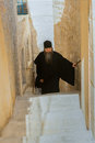 Pilgrims a priest in the greek orthodox monastery in the west bank of the jordan river in the judean desert in the kidron valley Stock Photography