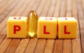 Pill concept image of over wooden background Royalty Free Stock Photo