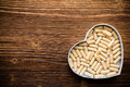 Pill heart shaped box wooden surface Stock Photos