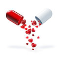 Pill of love with red hearts on a light background Royalty Free Stock Photos