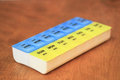Pill organizer with A.M. and P.M. doses Royalty Free Stock Photo