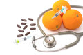 Pill stethoscope syringe with orange fruit vitamin c supplement and nutrition concept Royalty Free Stock Photo