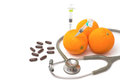 Pill stethoscope syringe with orange fruit vitamin c supplement and nutrition concept Stock Photo