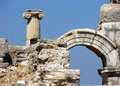 Pillar arch and ruins in ephesus turkey vertical photo of with a blue sky Stock Photo