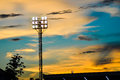 Pillar spotlights football field in the background blue sky at sunset Royalty Free Stock Photography