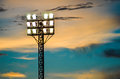 Pillar spotlights football field in the background blue sky at sunset Royalty Free Stock Photos