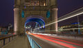 Pillar tower bridge london capital uk night traffic passing leaving traces light Stock Photos
