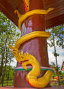 Pillars with serpent gold strap the pillar Royalty Free Stock Photography